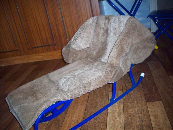 примерка чехла на санки