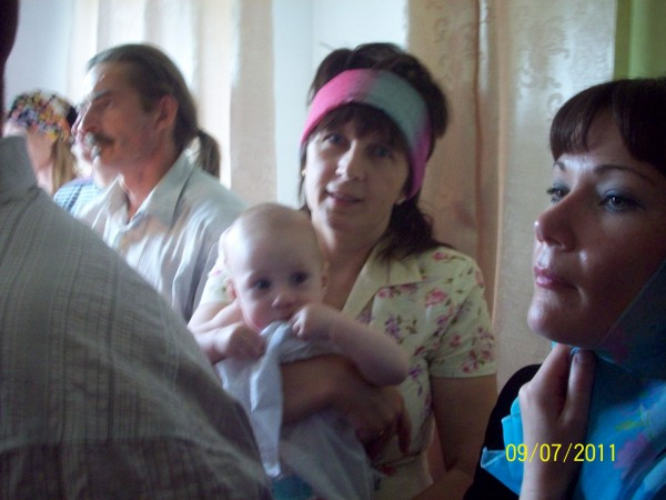 Крещение Егора, а рядом - лёля Дима